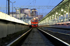 Train on Moscow passenger platform at night (Belorussky railway station) is one of the nine main railway stations in Moscow Stock Photography