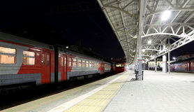Train on Moscow passenger platform at night (Belorussky railway station) is one of the nine main railway stations in Moscow Stock Image