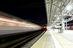 Train on Moscow passenger platform at night (Belorussky railway station) is one of the nine main railway stations in Moscow Stock Photos