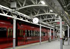 Train on Moscow passenger platform at night (Belorussky railway station) is one of the nine main railway stations in Moscow Royalty Free Stock Image