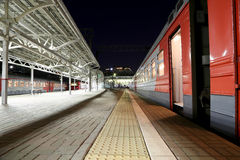 Train on Moscow passenger platform at night (Belorussky railway station) is one of the nine main railway stations in Moscow Royalty Free Stock Images
