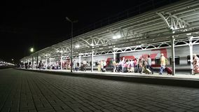 Train on Moscow passenger platform at night Belorussky railway station -- is one of the nine main railway stations in Moscow. Russia. It was opened in 1870 and stock video