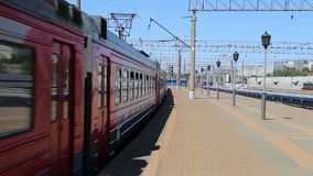 Train on Moscow passenger platform (Yaroslavsky railway station) and passengers, Russia. Is one of nine main railway stations in Moscow, situated on stock video footage