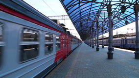 Train on Moscow passenger platform (Yaroslavsky railway station) and passengers, Russia. Is one of nine main railway stations in Moscow, situated on stock footage