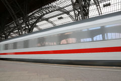 Train in Motion. At a railwaystation Stock Photography