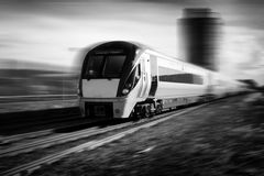 Train in motion black and white. Modern passenger train in motion with blured background Royalty Free Stock Image