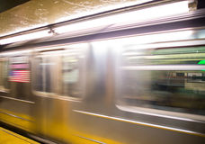 Train in motion inside a subway station, New York Stock Photo