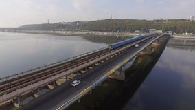 Train in Motion at The Metro Bridge through the Dnipro river in Kiev. Aerial stock footage