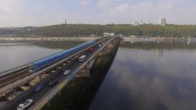 Train in Motion at The Metro Bridge through the Dnipro river in Kiev. Aerial stock video