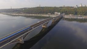 Train in Motion at The Metro Bridge through the Dnipro river in Kiev. Aerial stock video footage