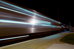 Train in Motion. Passenger train leaving the platform Royalty Free Stock Image