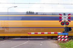 Train with motion at railway crossing Stock Image