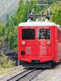 Train at mountain railway station Royalty Free Stock Images