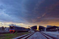 Train move out railway station on sunset Royalty Free Stock Photography