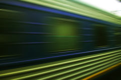 Train moves on a rail way. Royalty Free Stock Photo