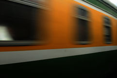 Train moves on a rail way. Royalty Free Stock Photography