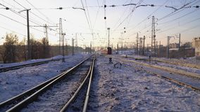 The train moves by rail Winter Sunny morning stock video footage