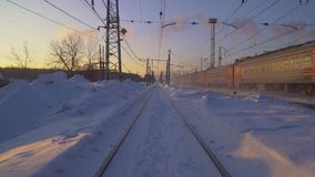 The train moves by rail Winter Sunny morning stock video