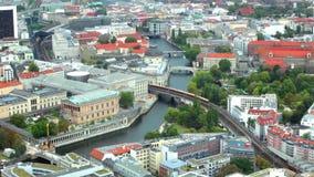 Train moves through river Spree on railway bridge in Berlin stock footage