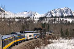 Train is moving along mountains Stock Photos