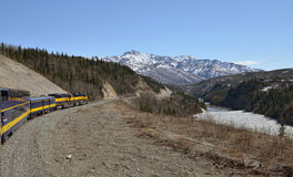 Train is moving along mountains Royalty Free Stock Photography