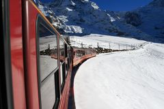 Train moving down the snow covered mountain in Jungfrau, Switzerland Royalty Free Stock Photo