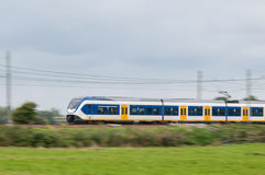 Train moving fast in landscape Royalty Free Stock Images