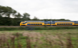 Train moving fast in landscape Stock Photo