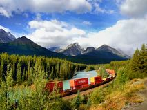 Train Moving in  Mountains Royalty Free Stock Photos