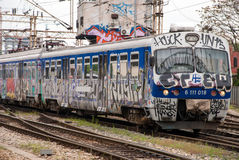 Train moving out of a station covered in graffiti in Zagreb, Cro Stock Photos