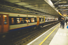 Train moving by platform Royalty Free Stock Images