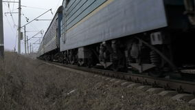 Train moving on the railway in the Ukrainian field. 4K stock footage