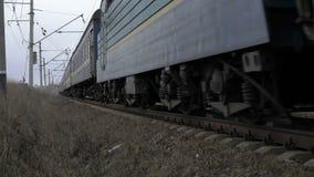 Train moving on the railway in the Ukrainian field. 4K stock footage