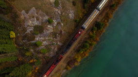Train moving scenic mountains. Aerial shot railway lake train stock video
