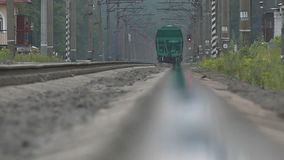 The train moving in slow motion - perspective view. stock footage