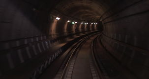Train moving through the subway tunnel, cabin view. Train moving along curved rail track in dark underground tunnel. View from the cabin. Paris, France stock footage
