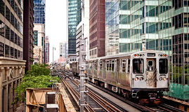 Train moving on the tracks in Chicago. Train moving on the tracks at CTA Station in Chicago Royalty Free Stock Photo