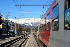 Train N snow capped mountains Stock Image
