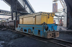 Train in national colors with trolleys in a coal mine. Ukraine Stock Photos