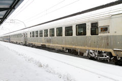 Train of the National Railway Company (CFR) who arrived during a snow storm Stock Photos