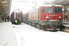 Train of the National Railway Company (CFR) who arrived during a snow storm Royalty Free Stock Images