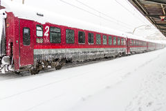 Train of the National Railway Company (CFR) who arrived during a snow storm Stock Image
