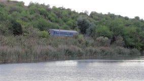 Train near the lake stock footage