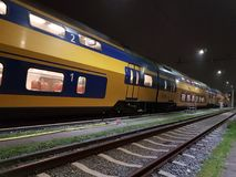 Train in netherlands. Dutch train called virm is yellow with bleu stock photos