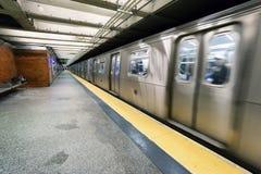 Train on New York City subway with homeless sleeping Stock Photos