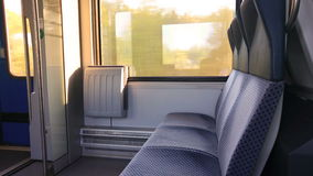 In the train next to the window, there are two chairs and door. Vide of in the train next to the window, there are two chairs and door stock video footage