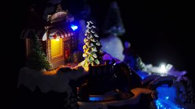 Christmas town and Christmas lights. Train in the night, Christmas tree, black background stock video footage