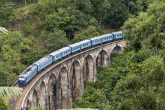 Train on Nine Arches bridge in hill country of Sri Lanka Royalty Free Stock Photography