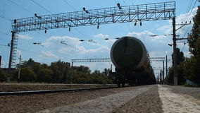 Train With Oil Tanks Moving Away stock footage