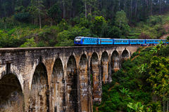 Train on the old arch bridge. Stock Photography